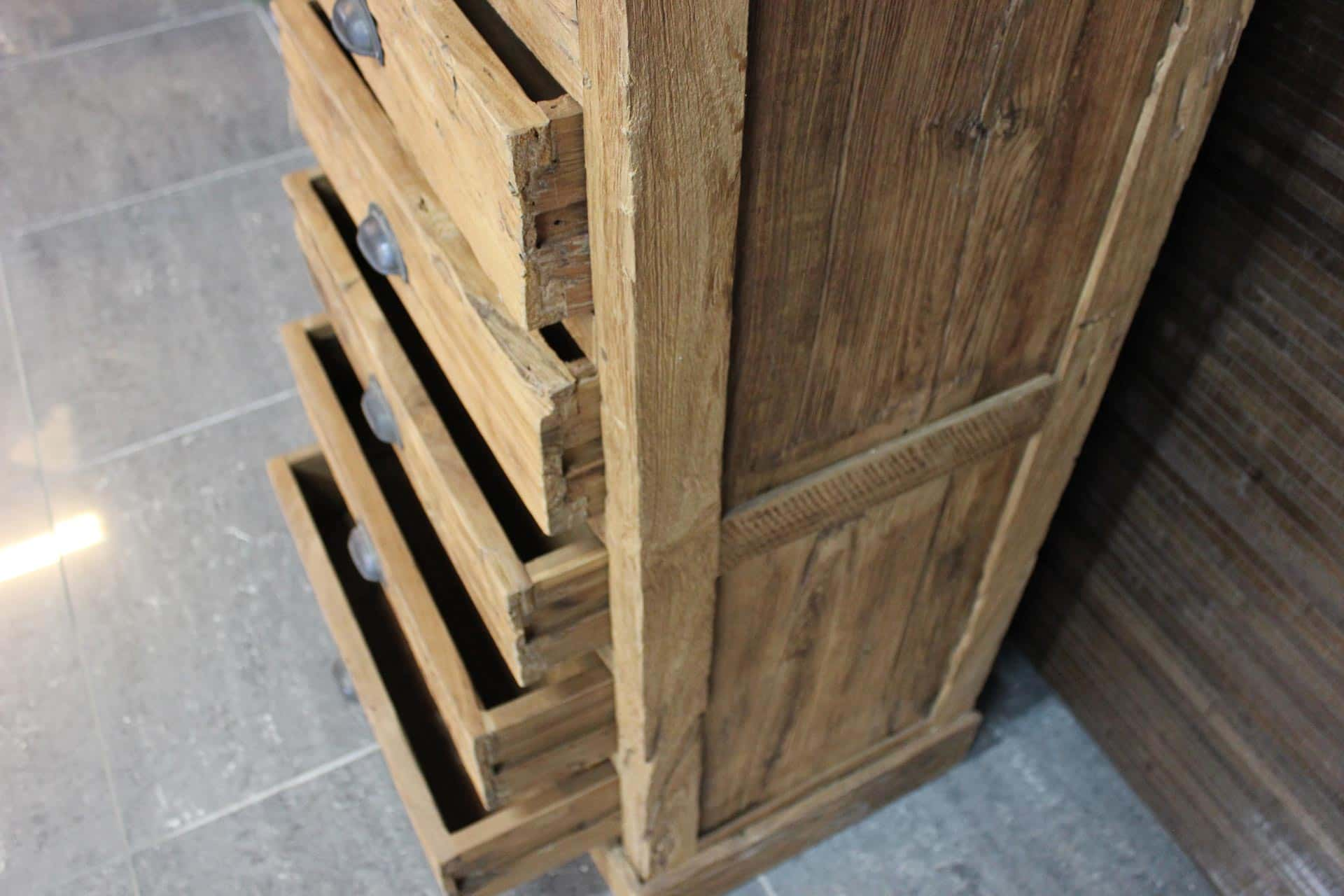 Cuci Remeh Laci 60E Old | narrow teak chest of drawers from Indonesia. This unusual narrow teak cabinet is made of old erosion teak. Furniture shop TEAK2.