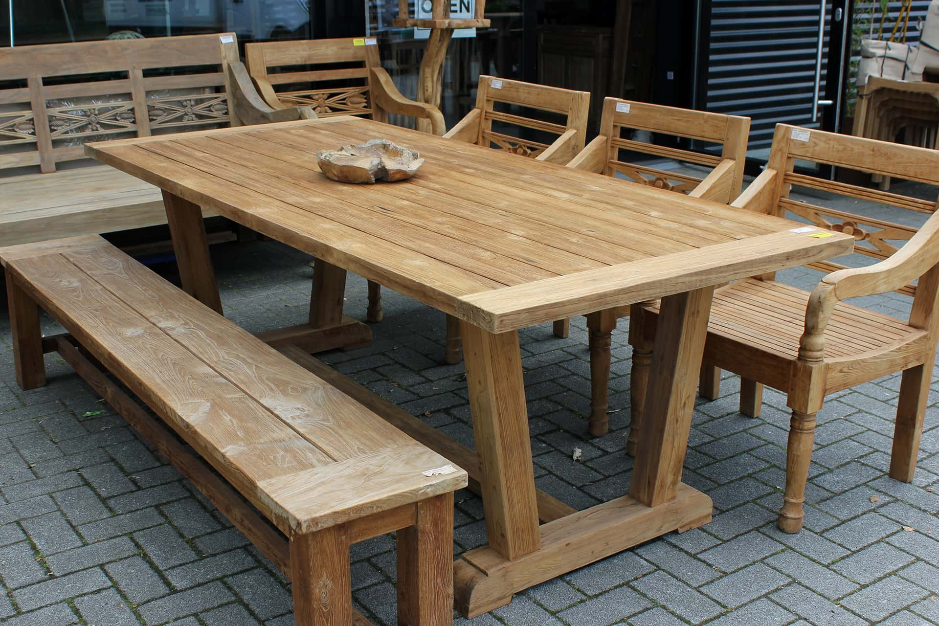 Teak Tangguh O220KV Old | wooden garden table with robust legs in V-profile. Teak garden table with a rural look and solid base - TEAK2.